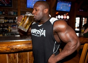 bodybuilder drinking a beer