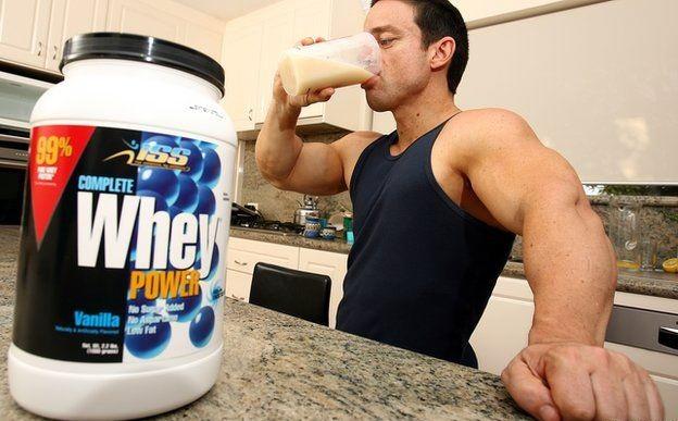 bodybuilder drinking protein shake